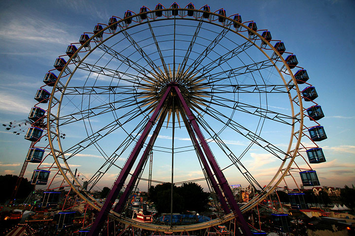 24 hours in pictures: A giant ferris wheel turns at the annual