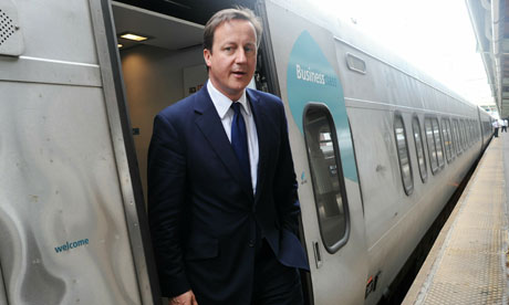 David Cameron takes the train