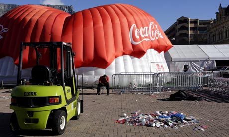 A security guard rests in Cape Town as South Africa sets about packing up after the World Cup.