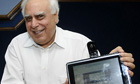 Kapil Sibal with the low-cost &#39;laptop&#39; computer device