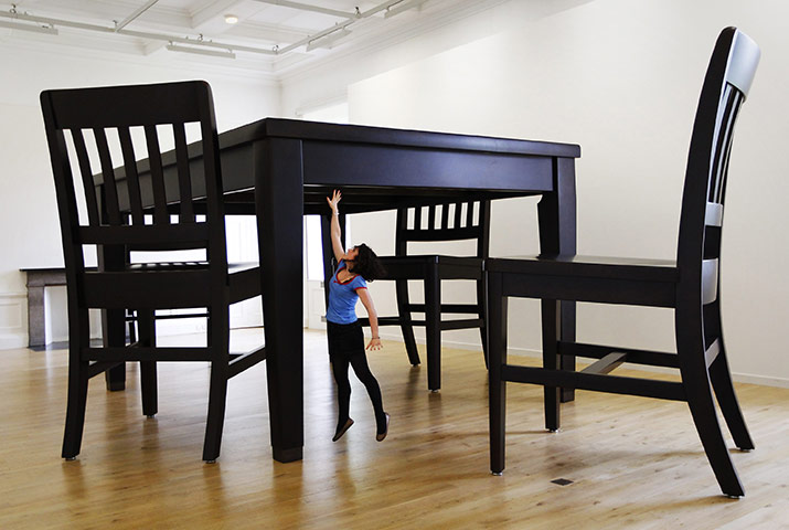 24 hours: A woman reaches No Title (Table and Four Chairs), 2003, by Robert Therrien