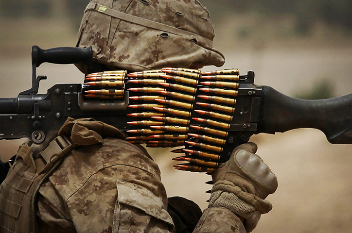 24 hours: A marine carries his weapons during an operation to clear insurgents