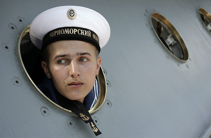 24 hours in pictures: Sevastopol, Ukraine: A Russian seaman looks out of a porthole