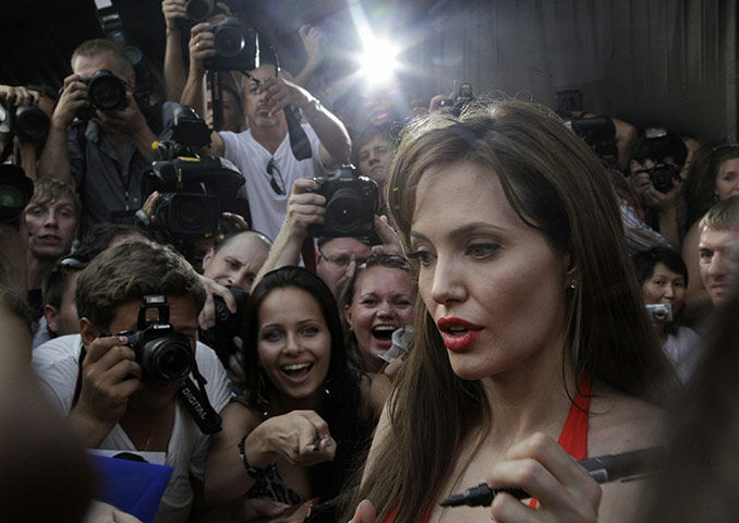 24 hours in pictures: US actress Angelina Jolie signs autograp