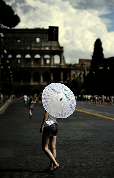 24 hours in pictures: A tourist walks on an empty Via dei Fori