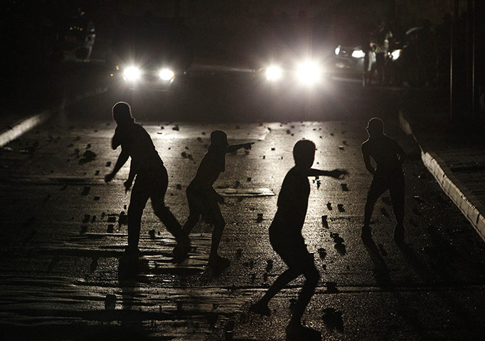 24 hours in pictures: Jerusalem: Palestinian youths throw stones
