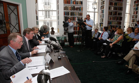 Sir Muir Russell, second left, talks to the media about his report into leaked climate change emails