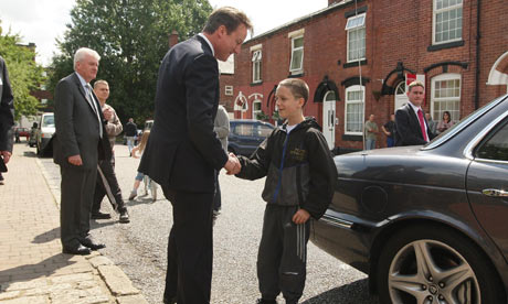 David Cameron shakes hands with 12-year-old Tyler Rushworth in Ashton-under-Lyne, on 10 August 2010.