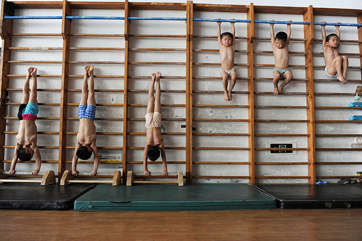 24 hours: Young gymnasts on wooden bars in sports school in Jiaxing
