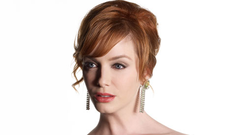 Christina Hendricks as Joan Harris (formerly Holloway) in Mad Men.