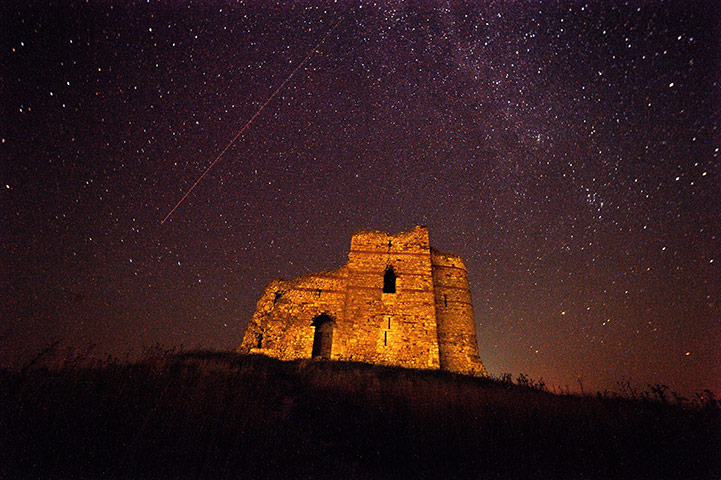 Perseid meteors: A meteor streaking across the night sky over Bukelon castle