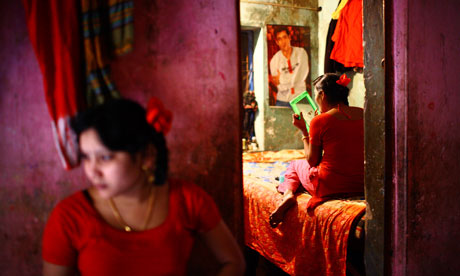 Asha and Suborna (background), young bonded sex workers in a brothel in Faridpur, Bangladesh.