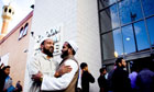 Muslim men greet each other outside Whitechapel Mosque in east London before Friday prayers