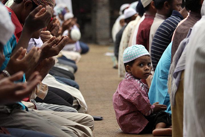 ramadan update: Child looks around during Friday prayers at Jamia mosque Amritsar, India