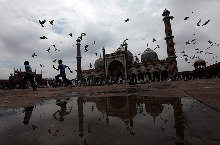 ramadan update: Children run around inside the premises of Jama mosque, India