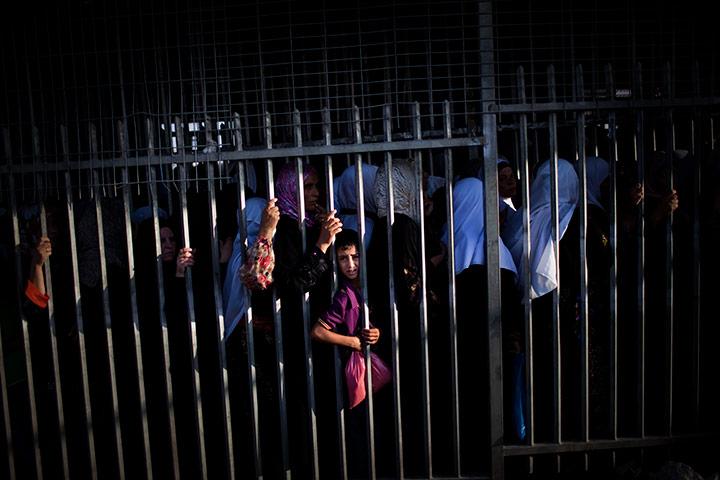 ramadan update: Child stands amongst Palestinian women, Al Aqsa Mosque Bethlehem, West Bank