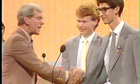 Bob Holness shakes hands with Ben Moor.