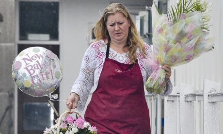 A florist arrives at the hospital in Truro bearing gifts for the Cameron family
