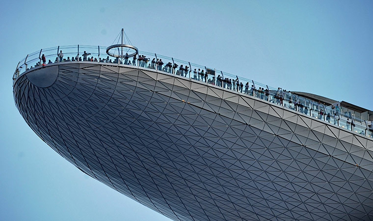 Visitors look out from the skypark of the 55-storey hotel tower at Marina Bay Sands