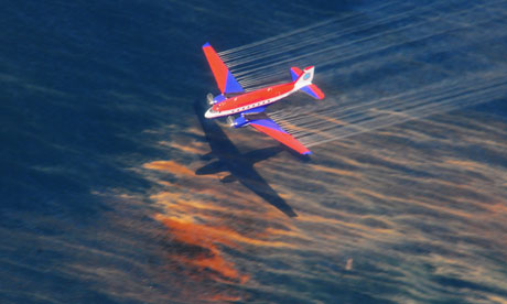 A plane releases chemical dispersant over the Gulf oil spill