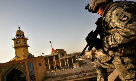 A US soldier on a rooftop in Samarra, the scene of heavy civilian casualties in October 2004