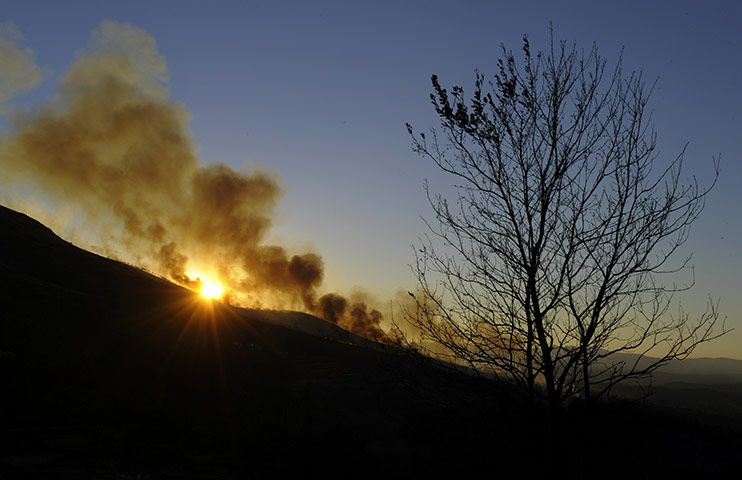 24 hours in pictures: A wildfire is seen in Portugal