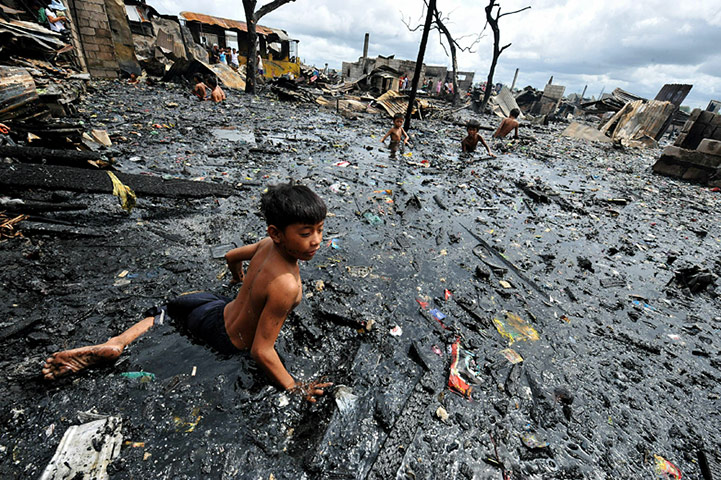 24 hours in pictures: Children look for salvageable materials