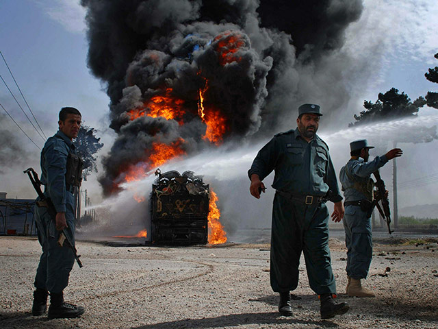 24 hours in pictures: Herat, Afghanistan: Police guard the site of a suicide bomb attack