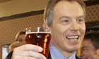 Tony Blair enjoys a pint.