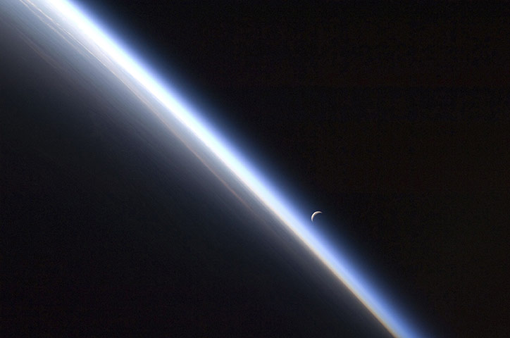 A last quarter crescent moon and the thin line of Earth's atmosphere