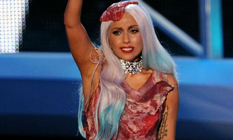 lady gaga meat dress images. Lady Gaga at the 2010 MTV