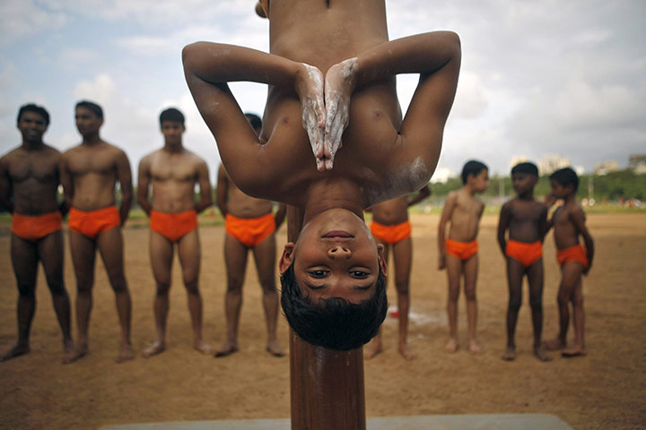 A boy practices Mallakhamb, a combination of traditional Indian gymnastics and martial arts