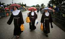 Nuns await the arrival of Pope Benedict XVI in Cofton Park, Birmingham