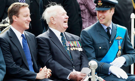 Prince William laughs with Wing Commander Bob Foster and David Cameron at Battle of Britain service
