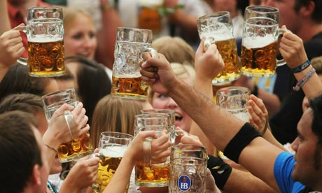 Visitors toast with beer mugs