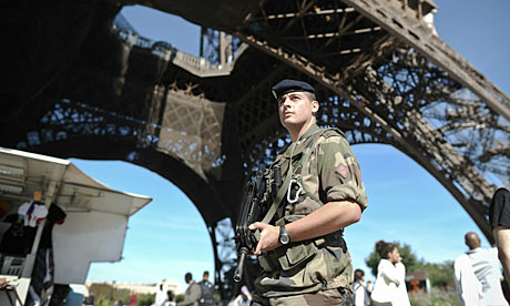French soldier patrols at the Eiffel tower in Paris