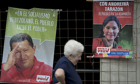 Election banners with portraits of Hugo Chavez and Congress candidate Andreina Tarazon in Caracas