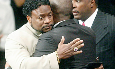 Bishop Eddie Long embraces a friend at his New Birth Missionary Baptist ...