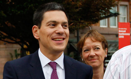 David Miliband arrives at the Labour party conference with his wife.