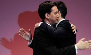 Ed Miliband and David Miliband embrace