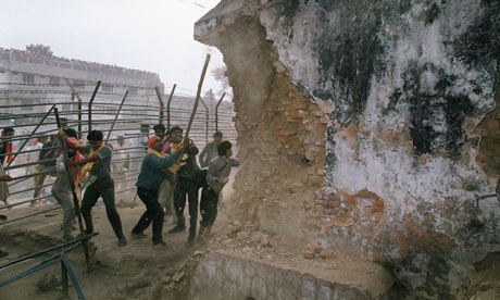 Indian Hindu fundamentalists attack the wall of the mosque in Ayodhya.