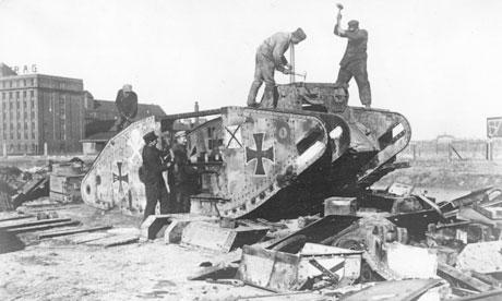 A tank is dismantled in Berlin, 1919.