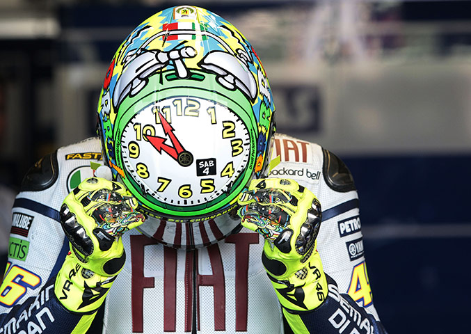 Valentino Rossi adjusts his helmet during the free practice session of the San Marino MotoGP grand prix