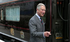 Prince Charles boards the royal train at Glasgow Central station