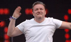 Ricky Gervais performs at Live8 concert in London, July 2005