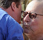 David Cameron, embraces his father Ian Cameron 