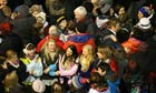 New year revellers sing Auld Lang Syne at Hogmanay in Edinburgh, Scotland