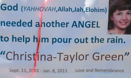 A sign left by mourners in remembrance of Christine-Taylor Green.