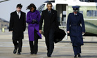 Barack Obama and his wife Michelle board Air Force One in Maryland to leave for Tucson, Arizona