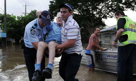 Police evacuate an 83-year-old resident in Brisbane